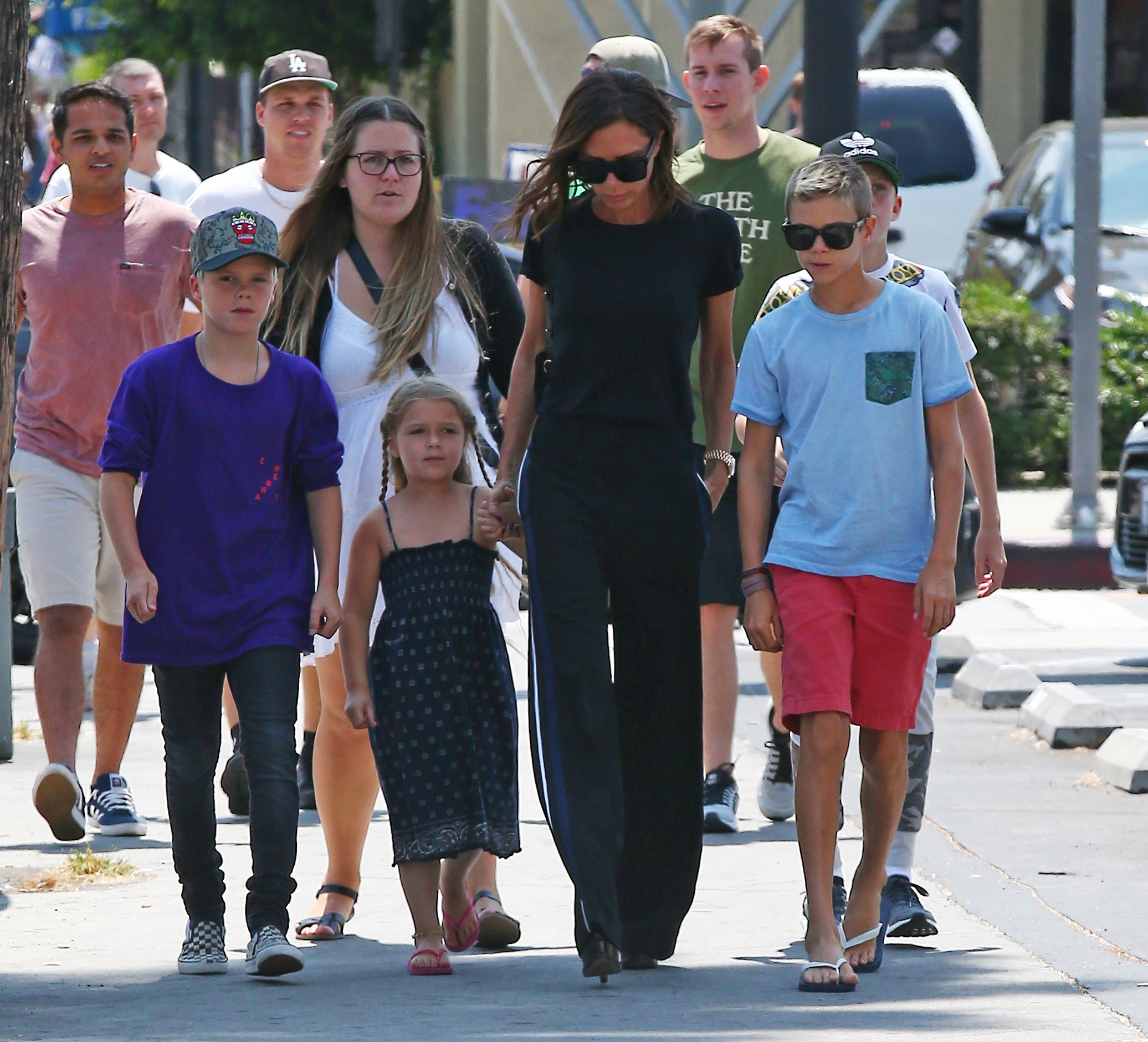 Picture Shows: Cruz Beckham, Harper Beckham, Victoria Beckham, Romeo Beckham August 21, 2016 £250 Per Pic For Mags and Double space rates for cover use * Former Spice Girl, Victoria Beckham steps out with her children, Harper, Romeo, and Cruz, for lunch at The Golden State in Los Angeles, California. The mother of 4 holds hands with youngest child, Harper as they walk through the street. £250 Per Pic For Mags and Double space rates for cover use * Exclusive - All Round UK RIGHTS ONLY Pictures by : FameFlynet UK © 2016 Tel : +44 (0)20 3551 5049 Email : info@fameflynet.uk.com