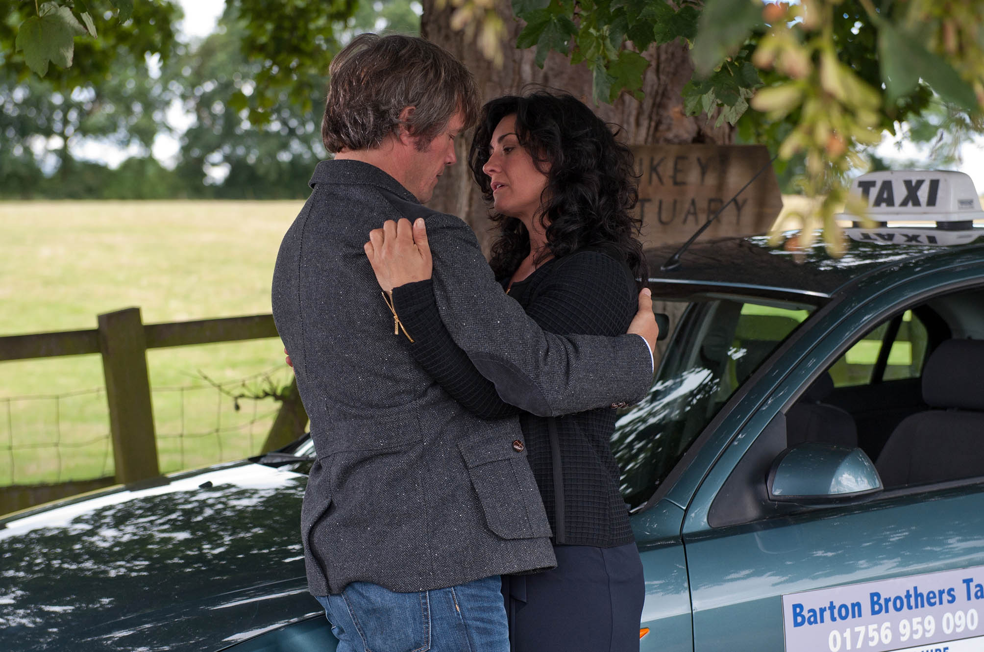 FROM ITV STRICT EMBARGO - NO USE BEFORE TUESDAY 30 AUGUST 2016 Emmerdale - Ep 7608 Tuesday 6th September 2016 On a country road, James Barton [BILL WARD] and Moira Barton [NATALIE J ROBB] rescue a donkey. Moira gets emotional about everyone leaving her, and James comforts her in the cab, their eyes meet and they move in for a passionate kiss... Picture contact: david.crook@itv.com on 0161 952 6214 Photographer - Amy Brammall This photograph is (C) ITV Plc and can only be reproduced for editorial purposes directly in connection with the programme or event mentioned above, or ITV plc. Once made available by ITV plc Picture Desk, this photograph can be reproduced once only up until the transmission [TX] date and no reproduction fee will be charged. Any subsequent usage may incur a fee. This photograph must not be manipulated [excluding basic cropping] in a manner which alters the visual appearance of the person photographed deemed detrimental or inappropriate by ITV plc Picture Desk. This photograph must not be syndicated to any other company, publication or website, or permanently archived, without the express written permission of ITV Plc Picture Desk. Full Terms and conditions are available on the website www.itvpictures.com