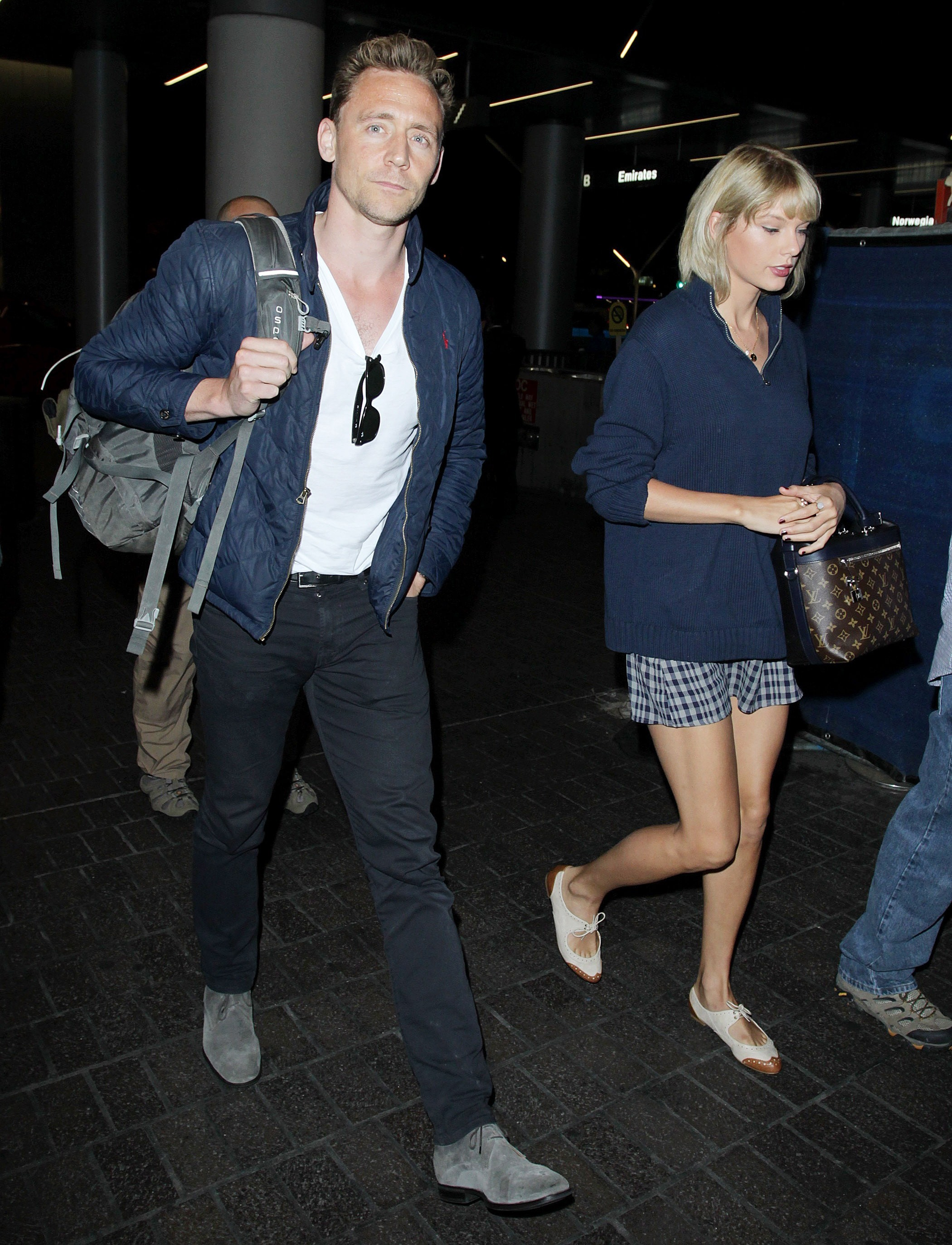 Picture Shows: Tom Hiddleston, Taylor Swift July 06, 2016 Tom Hiddleston and Taylor Swift arrive at LAX Airport from Rhode Island in Los Angeles, California. The couple dressed alike in navy blue hues. Non Exclusive UK RIGHTS ONLY (News International & Trinity Mirror Titles Only For Newspaper / No Associated Press Or Express Group EVER For Papers & Web) Pictures by : FameFlynet UK © 2016 Tel : +44 (0)20 3551 5049 Email : info@fameflynet.uk.com