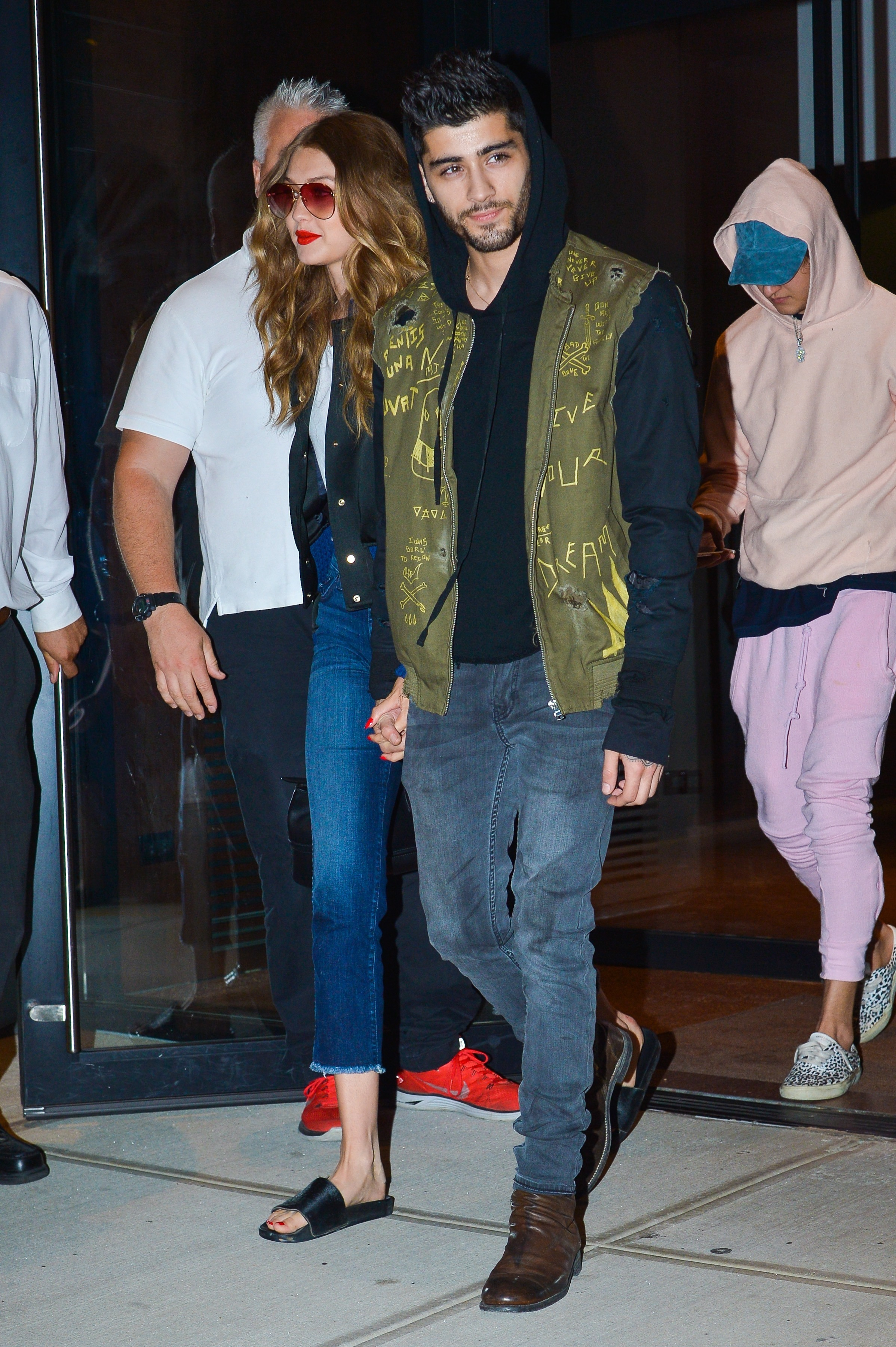 Picture Shows: Gigi Hadid, Zayn Malik July 14, 2016 Model Gigi Hadid and Zayn Malik were spotted out and about in New York City, New York. The two held hands with one another while walking through the bright flashy crowd. Non Exclusive UK RIGHTS ONLY Pictures by : FameFlynet UK © 2016 Tel : +44 (0)20 3551 5049 Email : info@fameflynet.uk.com