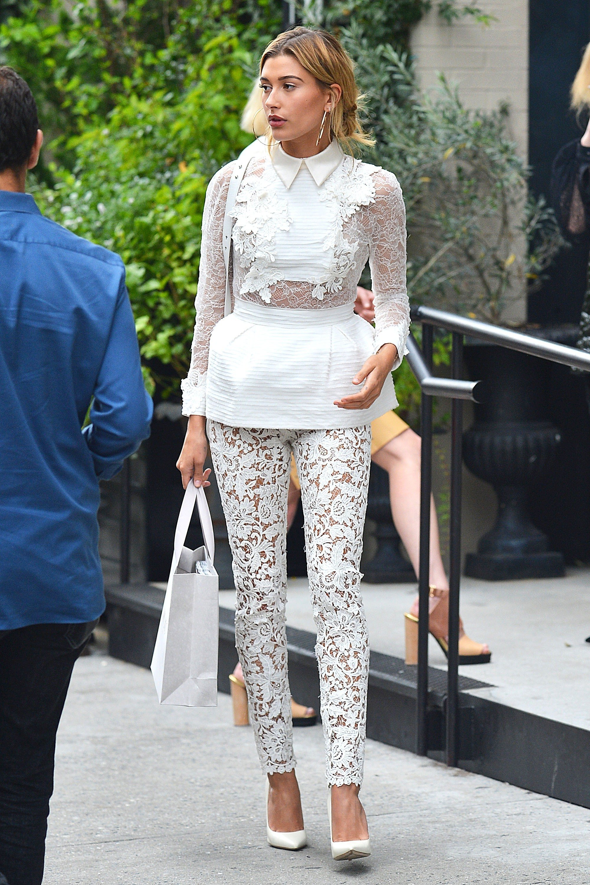 Picture Shows: Hailey Baldwin September 07, 2016 Model Hailey Baldwin is seen leaving Le Coucou Restaurant in Soho, New York City, during Fashion Week. The blonde beauty was carrying a Jimmy Choo carrier bag and rocking a racy, see-through lace ensemble with matching white pumps. Exclusive UK RIGHTS ONLY Pictures by : FameFlynet UK © 2016 Tel : +44 (0)20 3551 5049 Email : info@fameflynet.uk.com