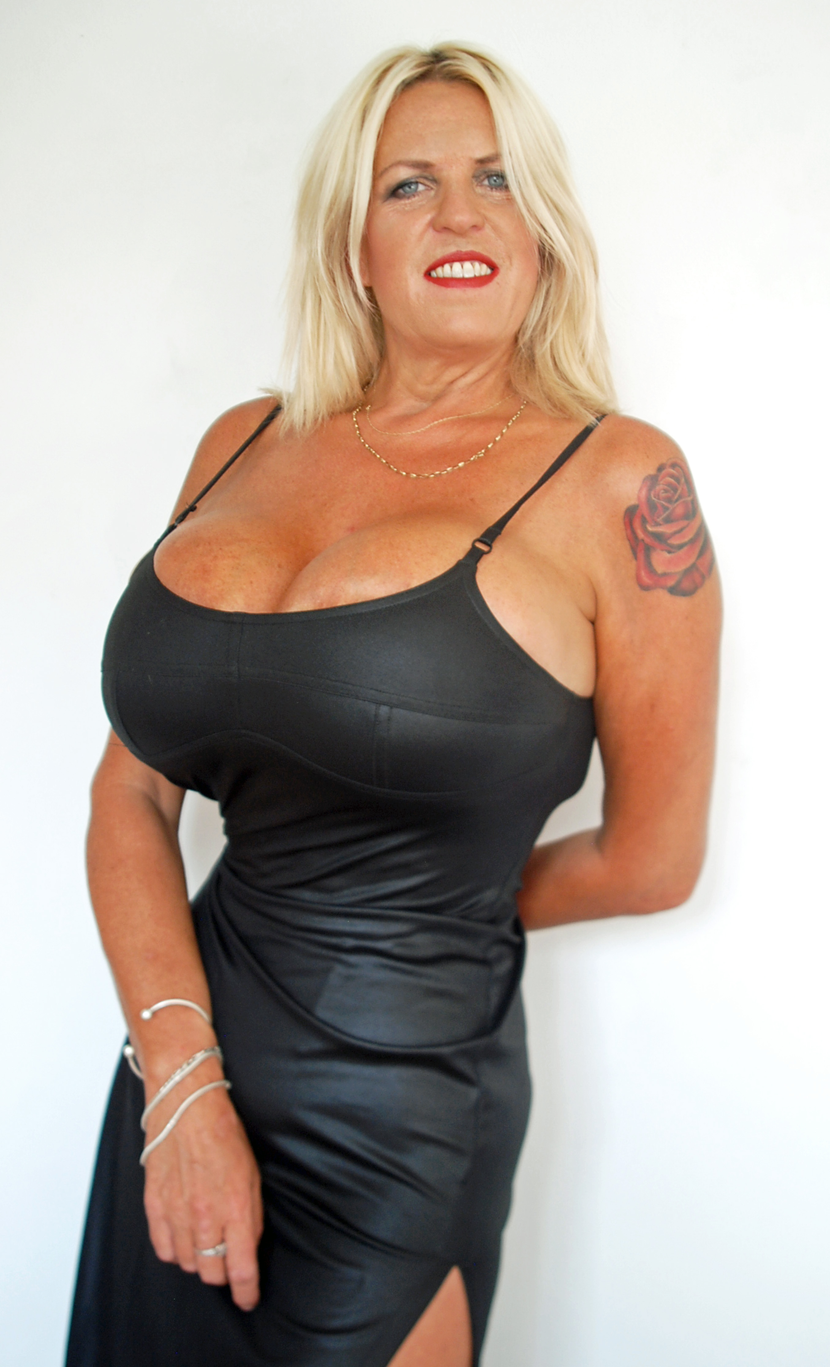 PIC FROM CATERS NEWS - (PICTURED: Sharon Perkins new waist after she began wearing her corset.) - Gran with biggest UK boobs has 24 inch waist after wearing rib crushing corset for 12 hours per day. Sharon Perkins, 50, from Coventry, West Midlands, swapped her 34D breasts for 32MM implants after forking out 10k but that wasnt enough for the body obsessed granny. She now wants a tiny 22inch waist to go with her gigantic assets in time for her September 2017 wedding. Inspired by Jessica Rabbit, Sharon is often seen wearing a tight red long dress, push up bras and a corset to enhance her figure. After spending a huge chunk of divorce cash on the half-a-stone implants, which needed to be specially imported from the US, the mum-of-three has also lost three stone in three months.Sharon insists her fianc, Carl Hamilton, 50, cant get enough of her body and says its brought the pair closer together. SEE CATERS COPY.