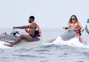FAMEFLYNET - Exclusive: Khloe Kardashian And Tristan Thompson Ride Jet Skis In Mexico