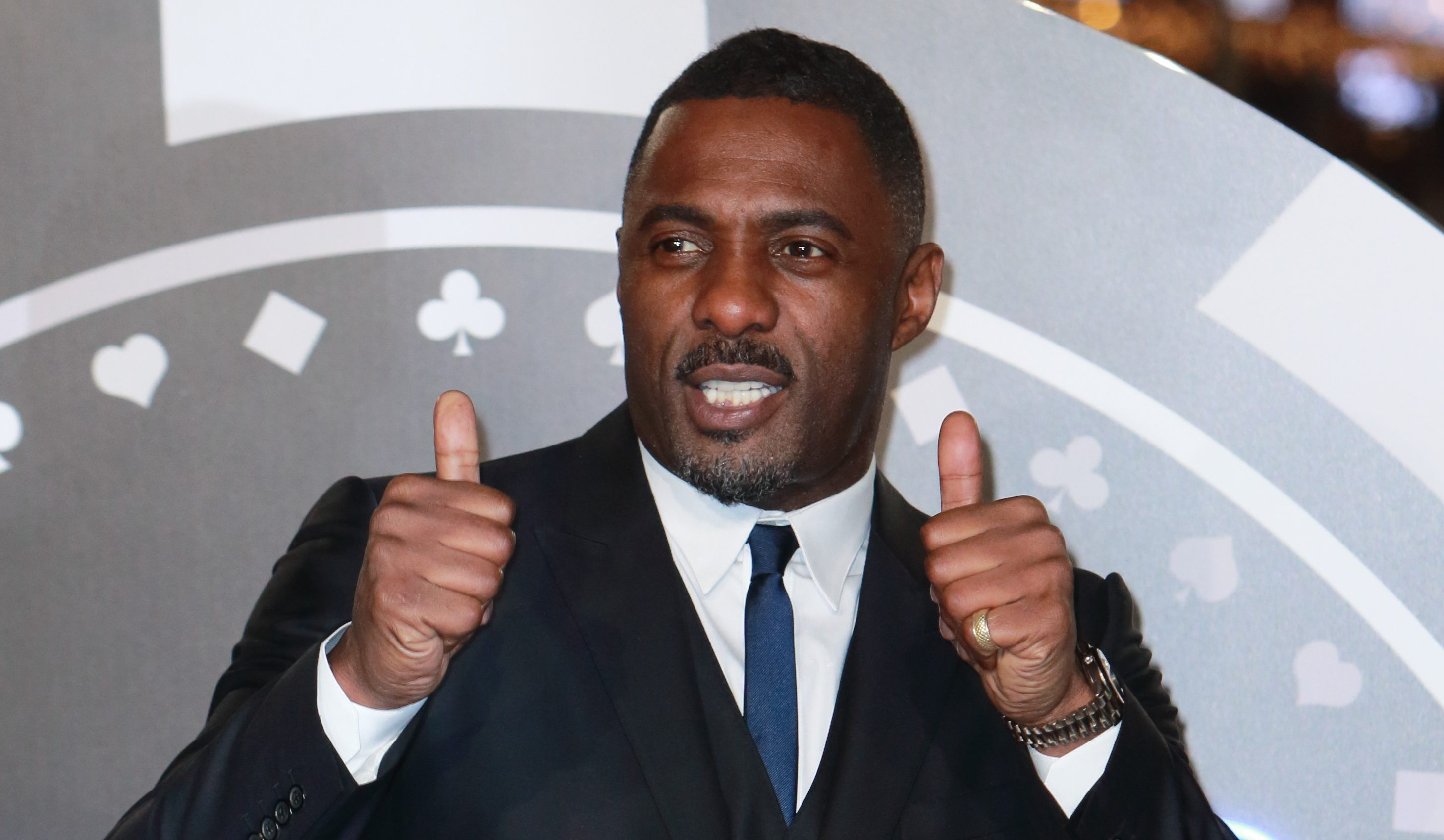Idris Elba proposes to girlfriend onstage at movie screening