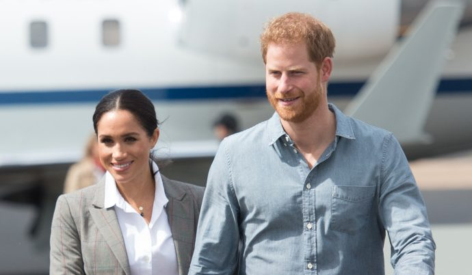 Duke and Duchess of Sussex share touching moment in the rain