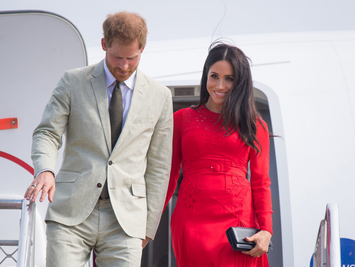 Expecting a Boy? Meghan Markle's Baby Blue Gown Raises Eyebrows