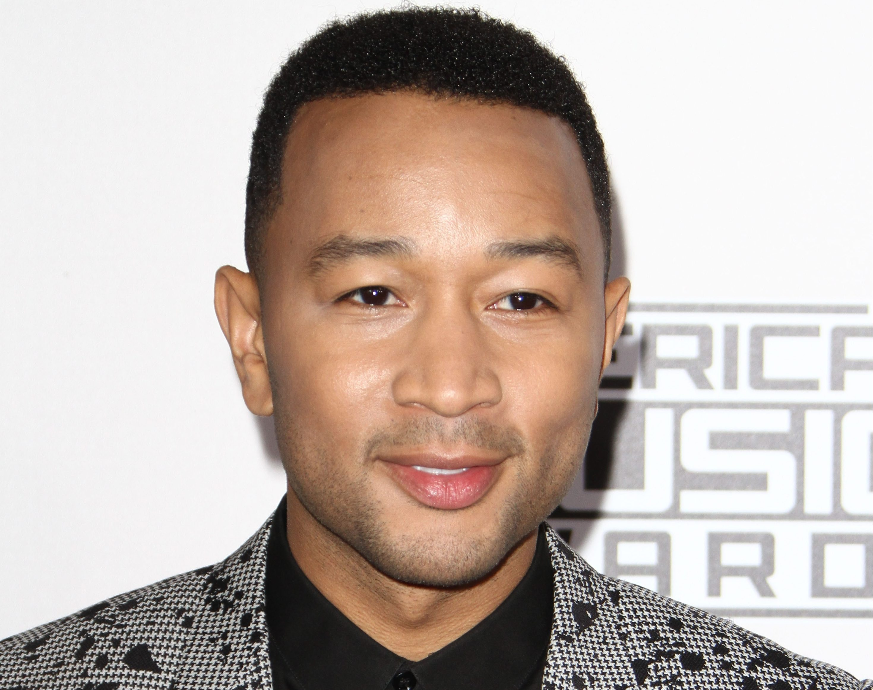 "John Legend slams Kanye West for his ""publicity stunt"" with Trump"