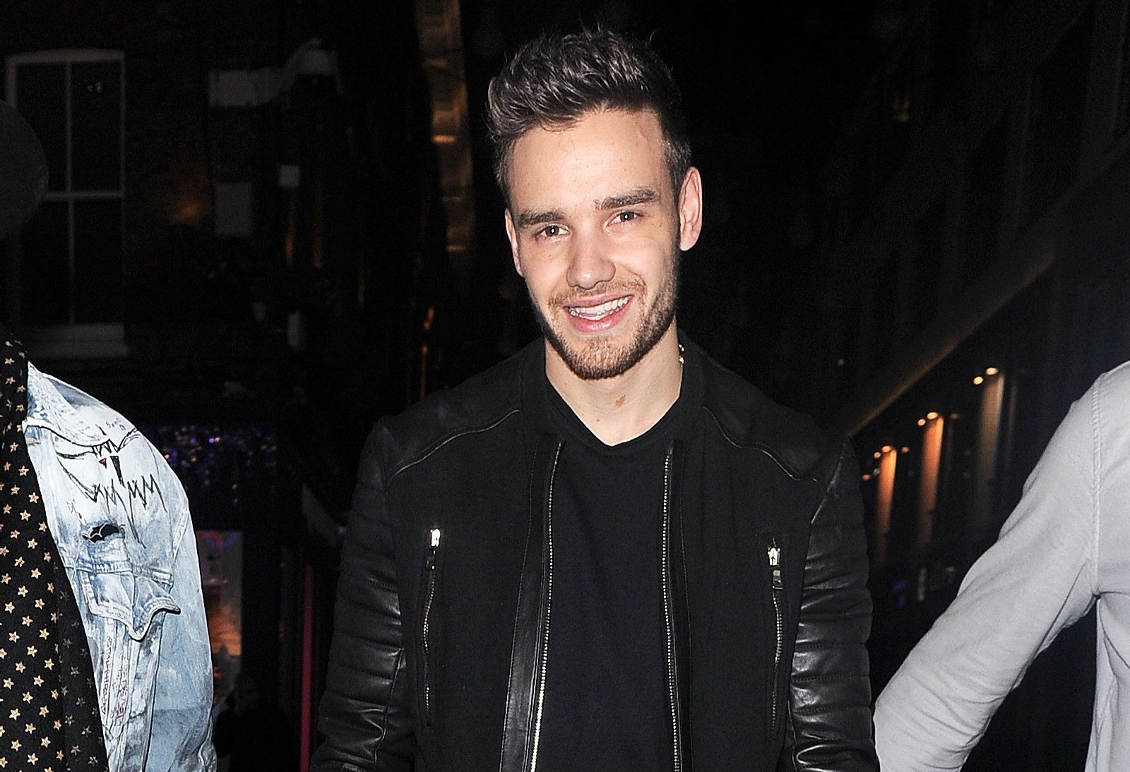 Liam Payne celebrates Bear's arrival on night out with lads