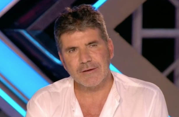 Simon Cowell stunned as former X Factor hopeful returns looking unrecognisable