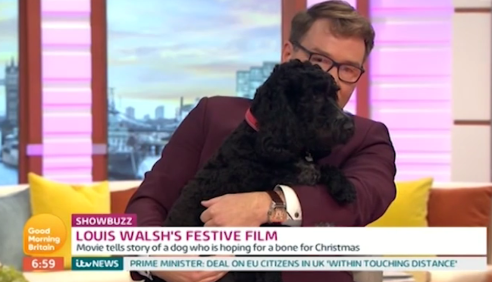 Viewers outraged as Richard Arnold drops dog on her head live on air