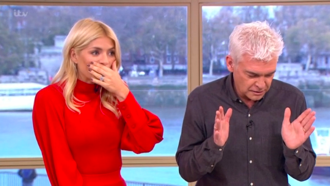 Fans in hysterics as Holly and Phil phone the wrong person live on air