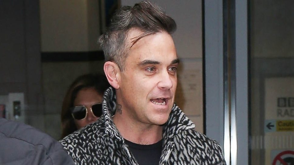 "Robbie Williams installed ""24-hour security"" around his home over alien fears"