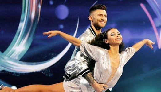 Jake Quickenden winces in agony and is given oxygen after Dancing On Ice injury