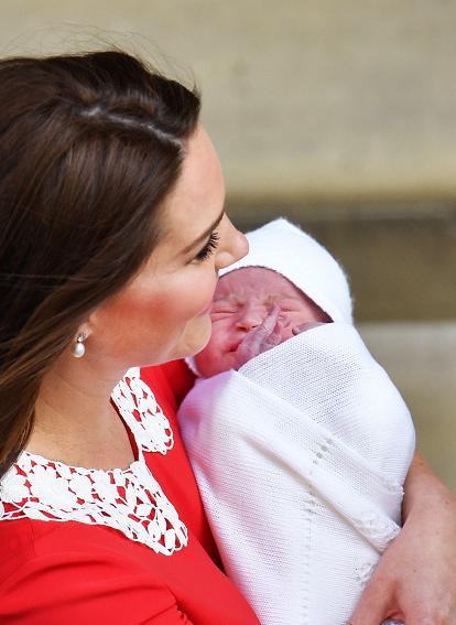 Kate cradles her newborn son