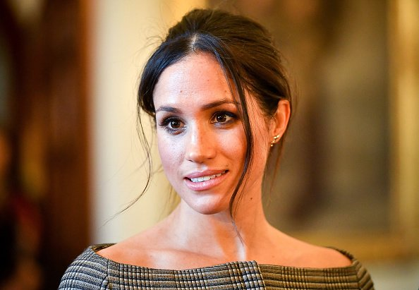 Meghan gives fashion tips during glowing outing