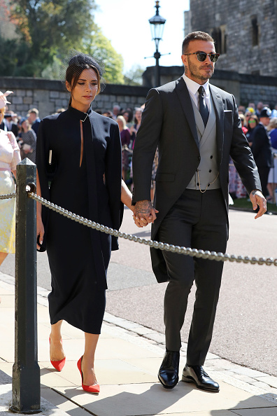 David Beckham and Victoria Beckham arrive at St George's Chapel at Windsor Castle before the wedding of Prince Harry to Meghan Markle on May 19, 2018 in Windsor, England. (Photo by Gareth Fuller - WPA Pool/Getty Images)