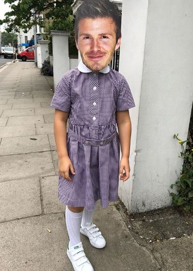 Harper Beckham wears mask of dad David's face on way to school