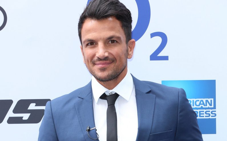 Peter Andre shares rare photo of sons Junior and Theo playing football