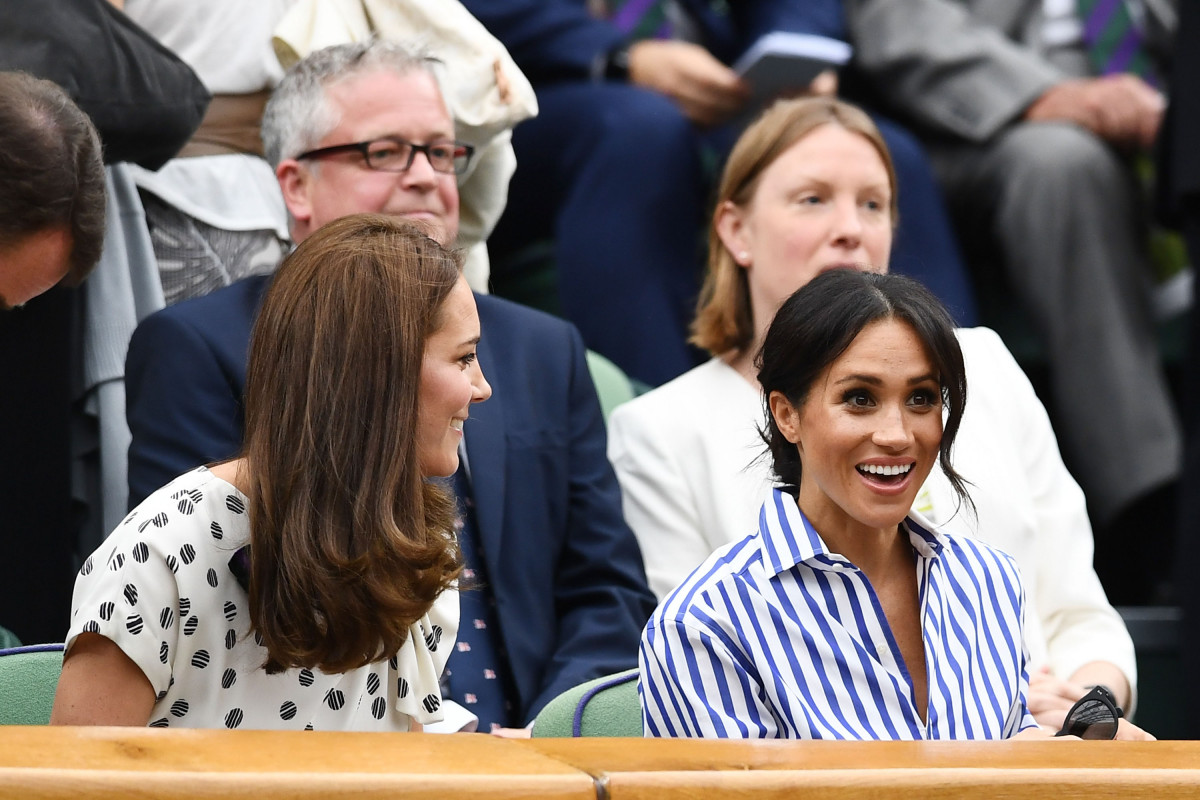 Catherine, Duchess of Cambridge and Meghan, Duchess of Sussex attend day twelve of the Wimbledon Lawn Tennis Championships at All England Lawn Tennis and Croquet Club on July 14, 2018 in London, England. (Photo by Clive Mason/Getty Images)