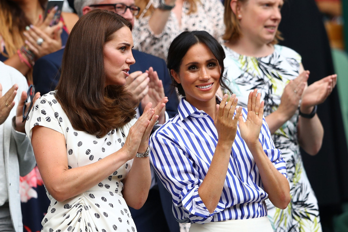 : Catherine, Duchess of Cambridge and Meghan, Duchess of Sussex applaud ahead of the Ladies' Singles final match between Serena Williams of The United States and Angelique Kerber of Germany on day twelve of the Wimbledon Lawn Tennis Championships at All England Lawn Tennis and Croquet Club on July 14, 2018 in London, England. (Photo by Michael Steele/Getty Images)