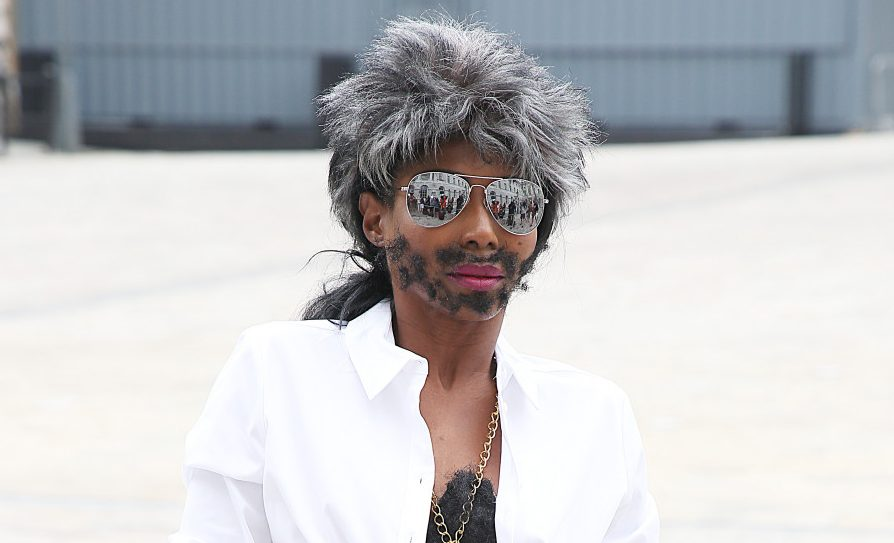 Sinitta dresses as Simon Cowell for X Factor judges' press conference