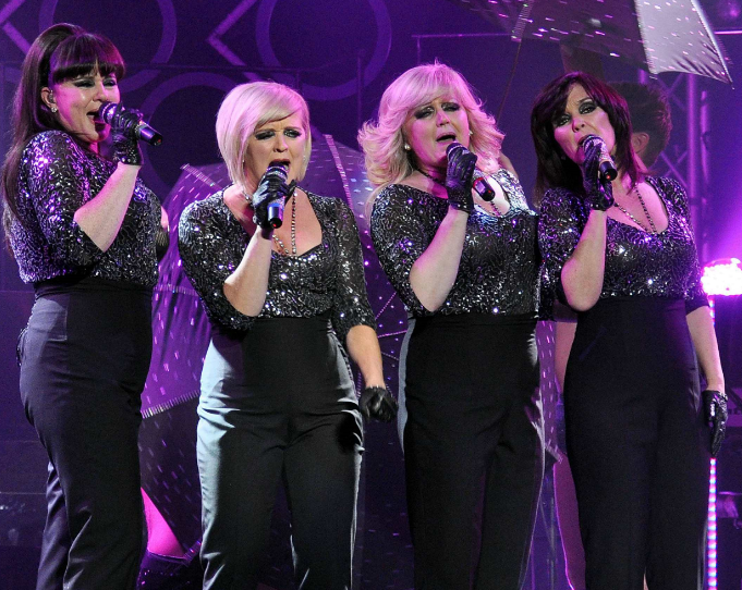 The Nolan sisters perform in 2013 (Credit: WENN)