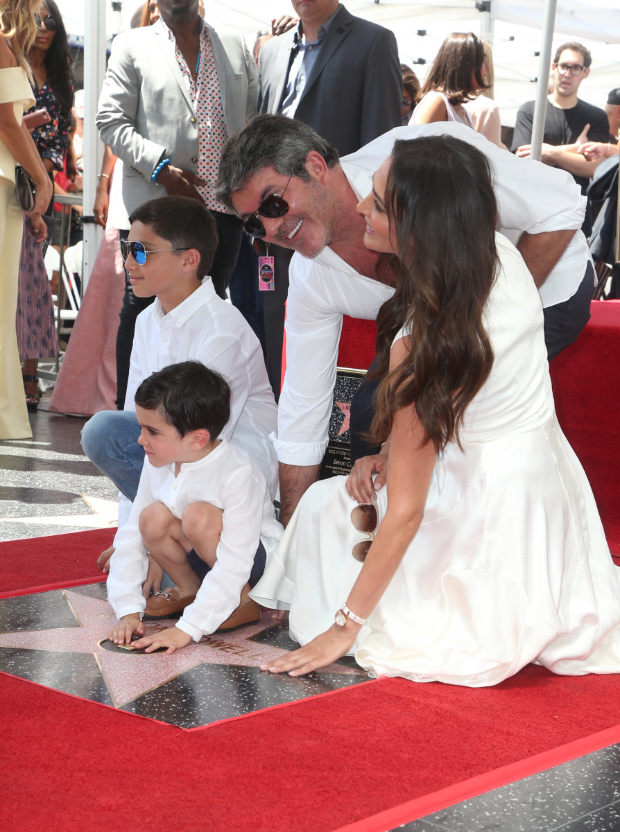 Simon Cowell with partner Lauren silverman and son Eric and her son Adam