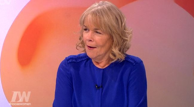 Linda Robson recreates Victoria Beckham's carrier bag pose and asks 'who wore it best'