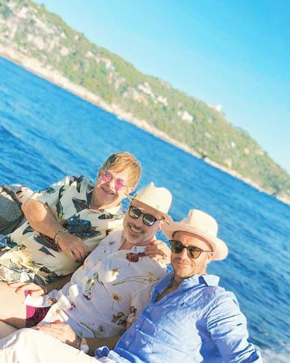Elton John, his husband David Furnish and David Beckham