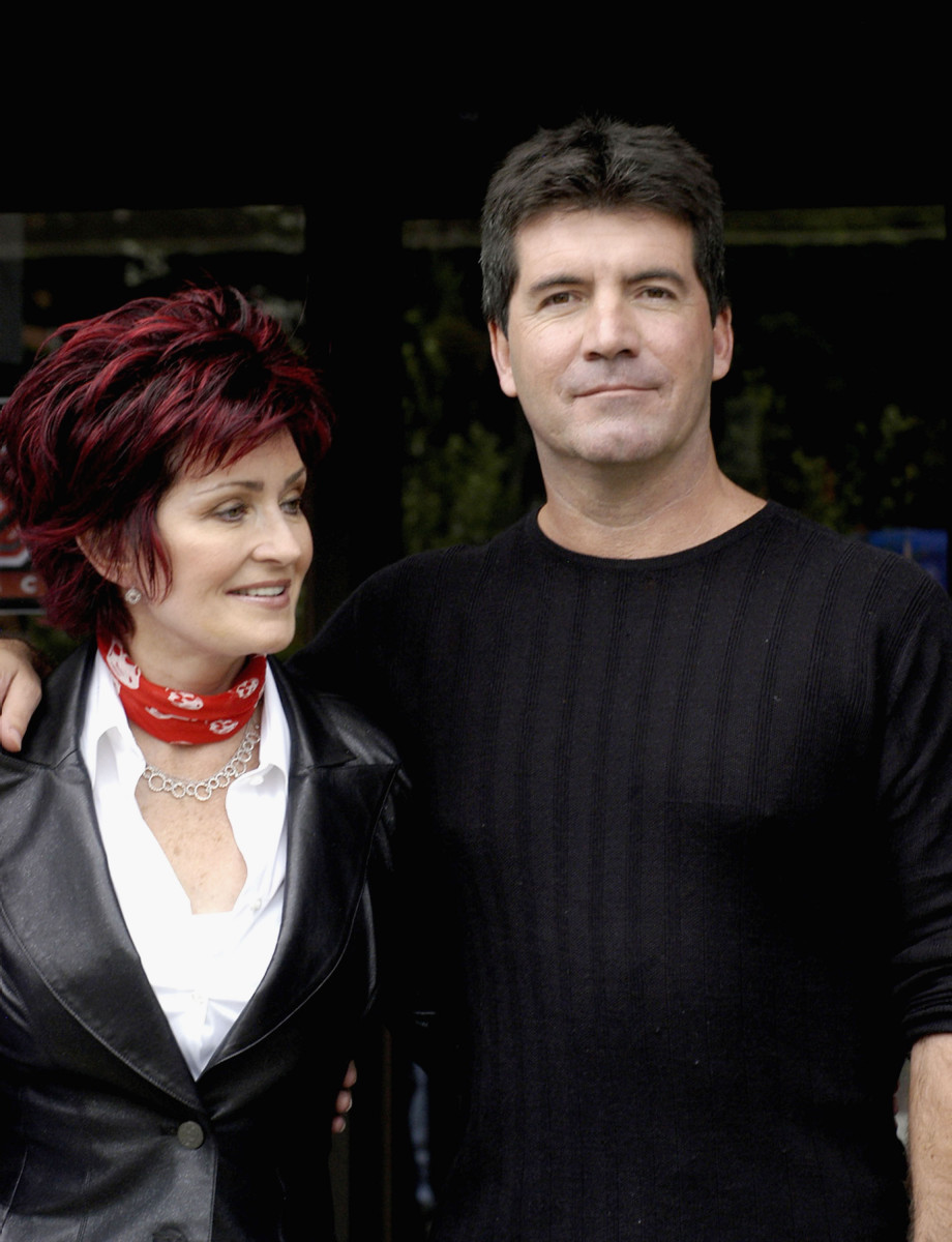 Sharon Osbourne and Simon Cowell pose for photos after auditioning hundreds of hopeful musicians for their new TV show 'X Factor' on Julr6, 2004