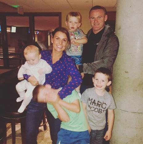 Coleen and Wayne Rooney with their children