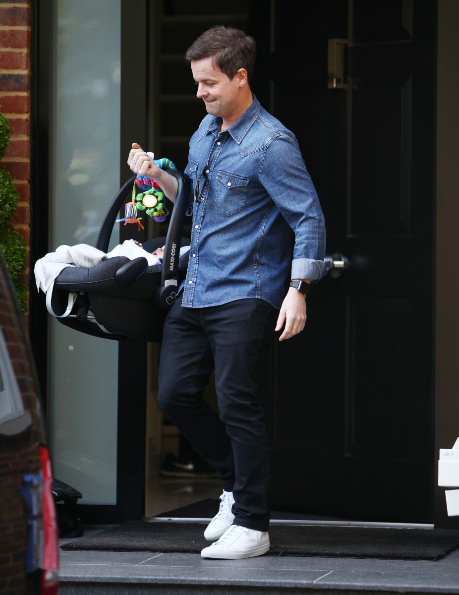 Declan Donnelly and Ali Astall leave home with baby Isla