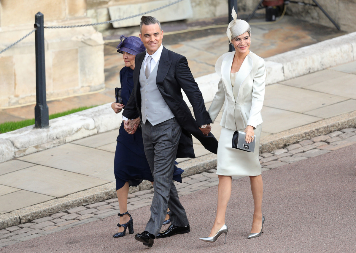 Gwen Field, Robbie Williams and Ayda Field arrive ahead of the wedding of Princess Eugenie of York and Mr. Jack Brooksbank at St. George's Chapel on October 12, 2018 in Windsor, England. (Photo by Aaron Chown - WPA Pool/Getty Images)