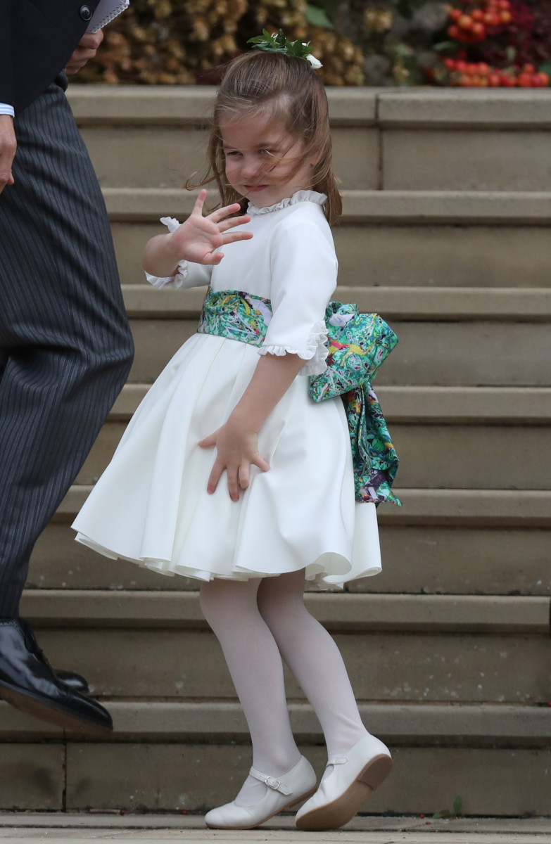 Bridesmaid Princess Charlotte of Cambridge waves as she arrives ahead of the wedding of Princess Eugenie of York and Mr. Jack Brooksbank at St. George's Chapel on October 12, 2018 in Windsor, England. (Photo by Steve Parsons - WPA Pool/Getty Images)