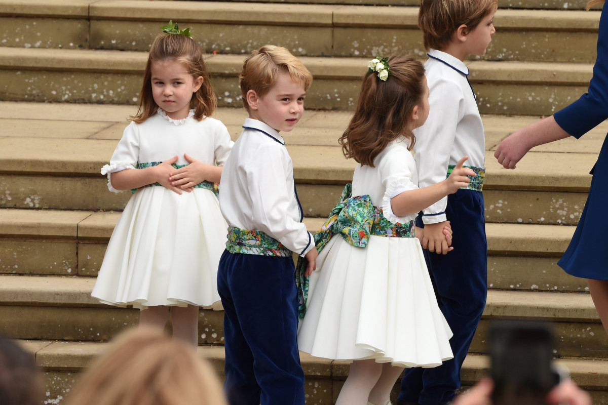 The bridesmaids and page boys including Prince George of Cambridge and Princess Charlotte of Cambridge arrive with Lady Louise Mountbatten-Windsor, for the wedding of Princess Eugenie to Jack Brooksbank at St George's Chapel in Windsor Castle on October 12, 2018 in Windsor, England. (Photo by Jeremy Selwyn - WPA Pool/Getty Images)