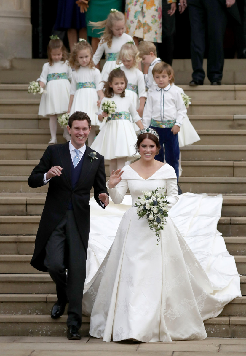 Jack Brooksbank and Princess Eugenie of York walk down the steps followed by their page boys and bridesmaids after their wedding ceremony at St. George's Chapel on October 12, 2018 in Windsor, England. (Photo by Andrew Matthews - WPA Pool/Getty Images)
