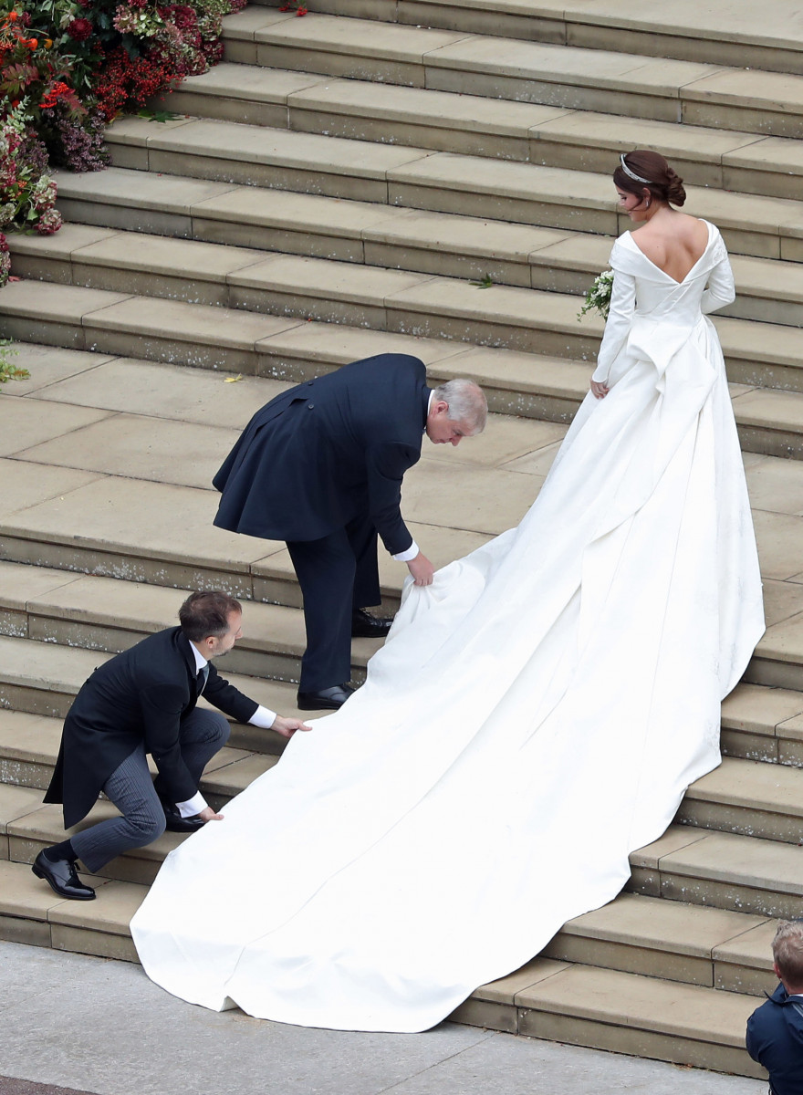 Princess Eugenie of York receives help with her train from her father Prince Andrew, Duke of York as she arrives to her wedding to Mr. Jack Brooksbank at St. George's Chapel on October 12, 2018 in Windsor, England. (Photo by Andrew Matthews - WPA Pool/Getty Images)