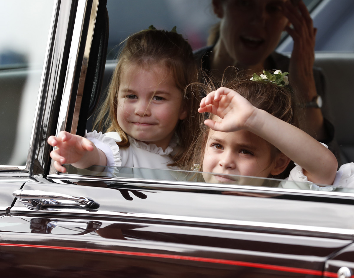 Flower Girls Princess Charlotte (L) and Theodora Williams wave following the wedding of Princess Eugenie of York and Mr. Jack Brooksbank at St. George's Chapel on October 12, 2018 in Windsor, England. (Photo by Alastair Grant - WPA Pool/Getty Images)