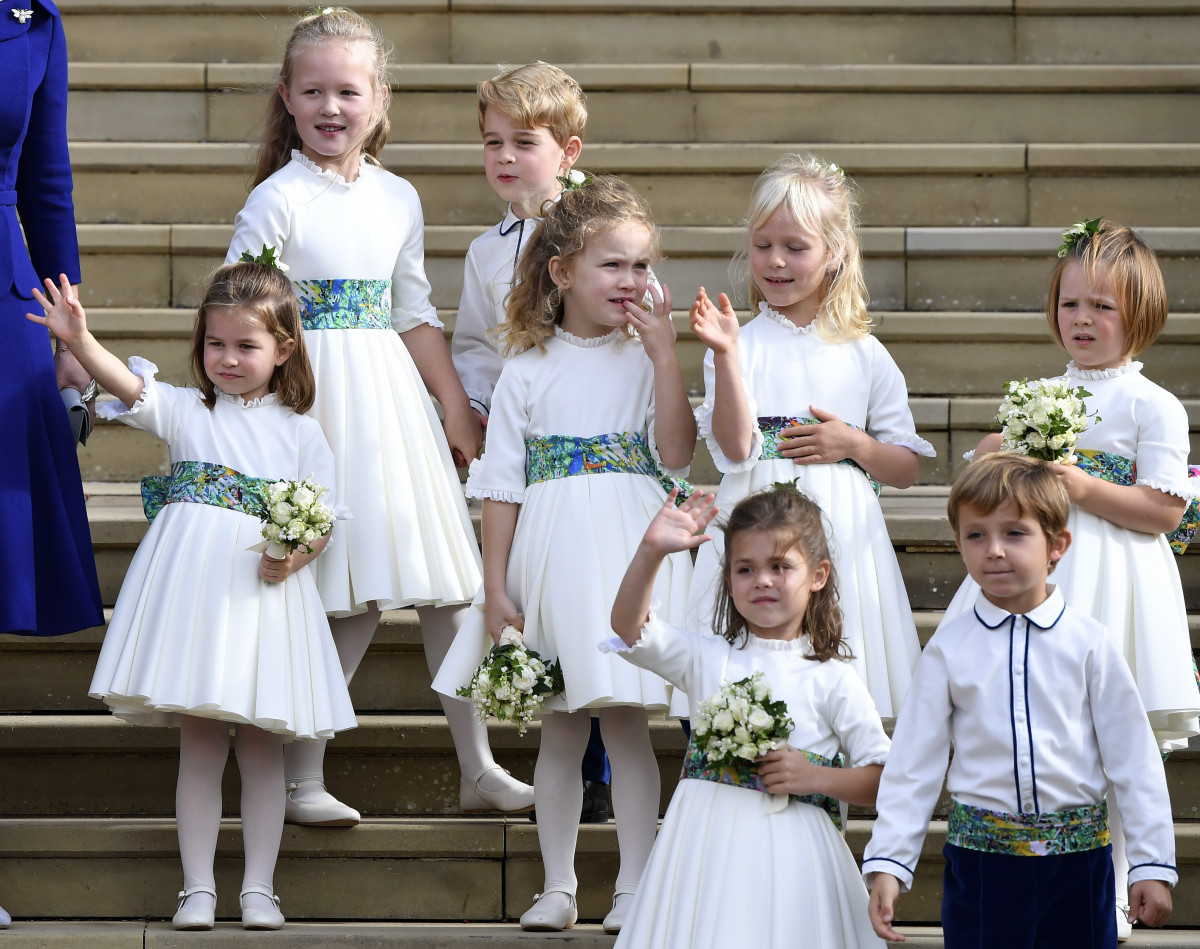 The bridesmaids and page boys, including Prince George and Princess Charlotte, wave as they leave after the royal wedding of Princess Eugenie of York of York and her husband Jack Brooksbank at St George's Chapel in Windsor Castle on October 12, 2018 in Windsor, England. (Photo by Toby Melville - WPA Pool/Getty Images)