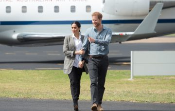 Prince Harry, the Duke of Sussex and Meghan, the Duchess of Sussex arrive at Dubbo Airport