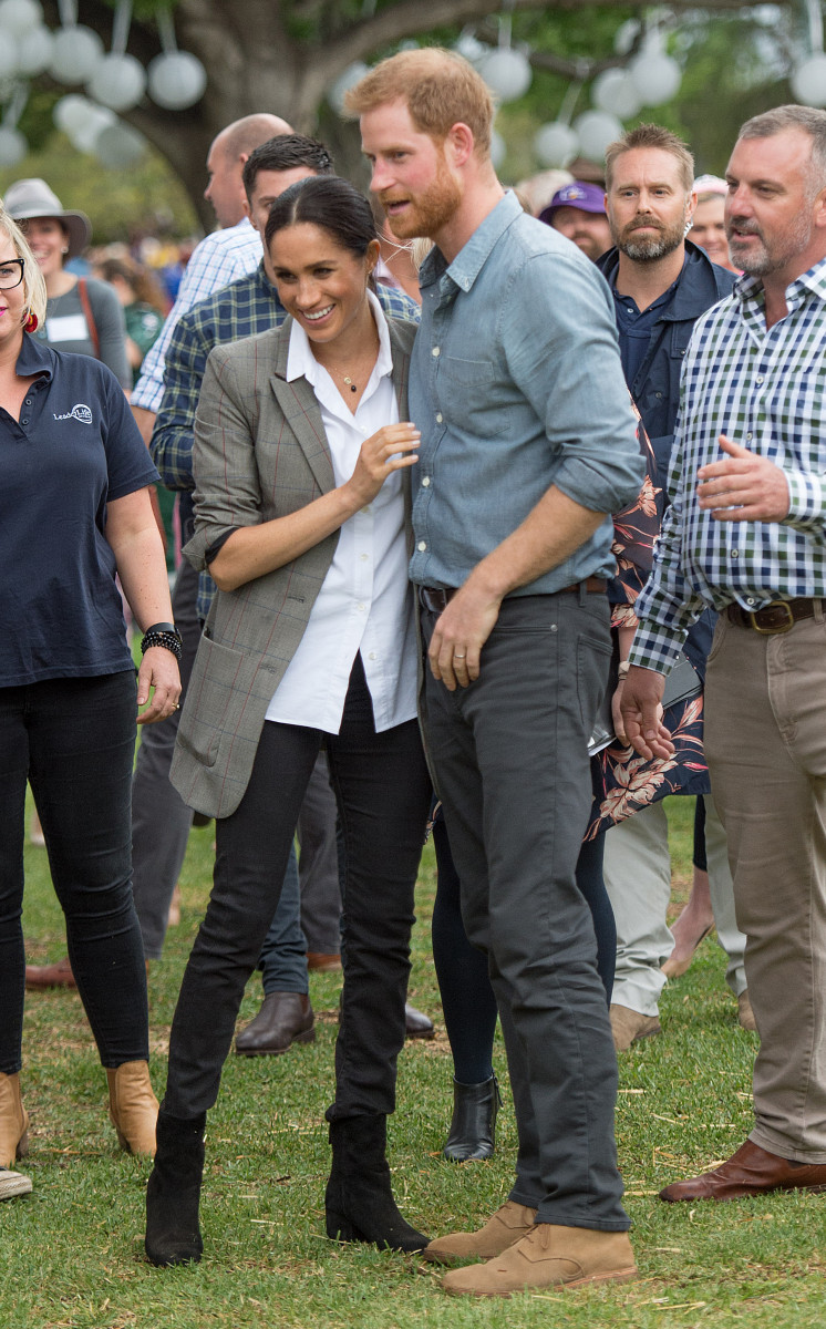 Prince Harry, the Duke of Sussex and Meghan, the Duchess of Sussex visit a Dubbo Community BBQ in Victoria Park