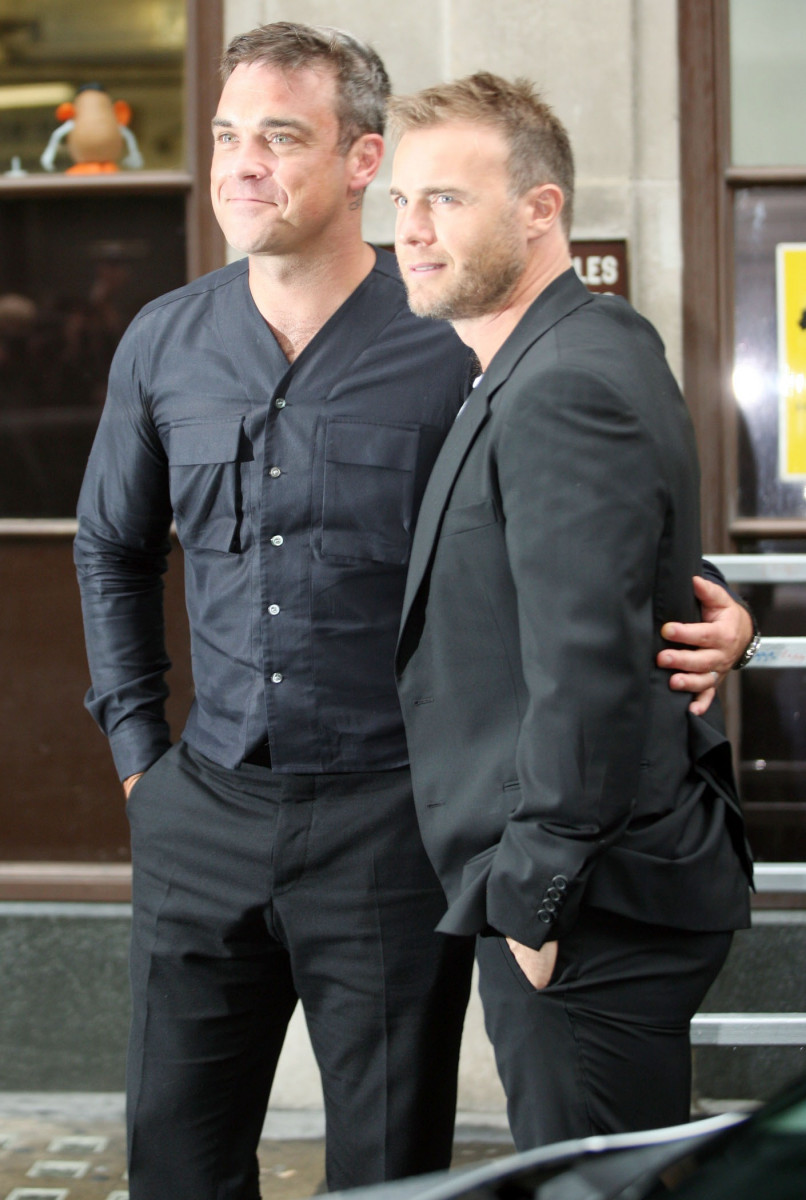 Singers Robbie Williams and Gary Barlow are pictured leaving BBC Radio 1.