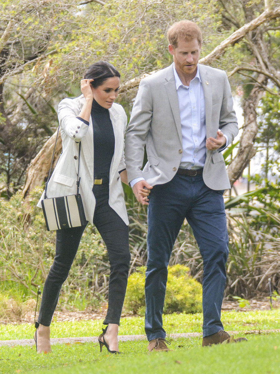 Meghan Markle arrives at Invictus Luncheon with Prince Harry, after missing morning events