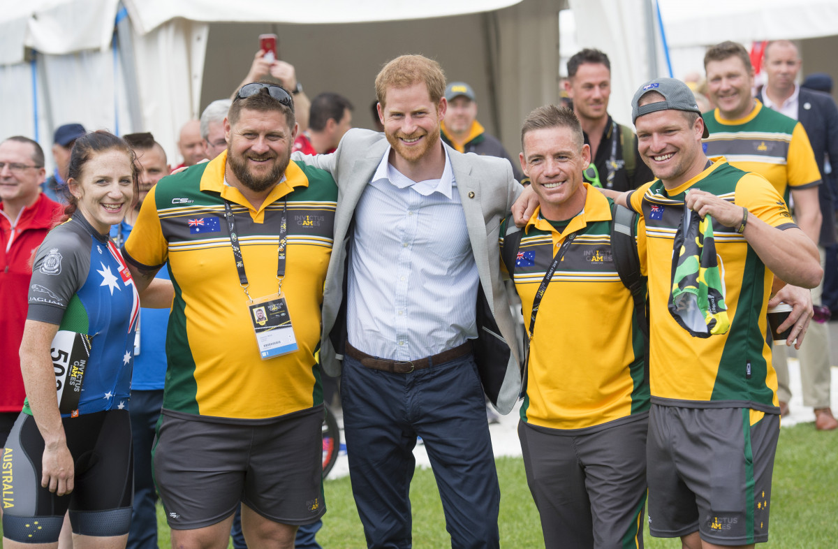 Prince Harry, the Duke of Sussex is presented with a pair of Invictus underwear by the Australian team during the Invictus Games cycling time trial in Sydney