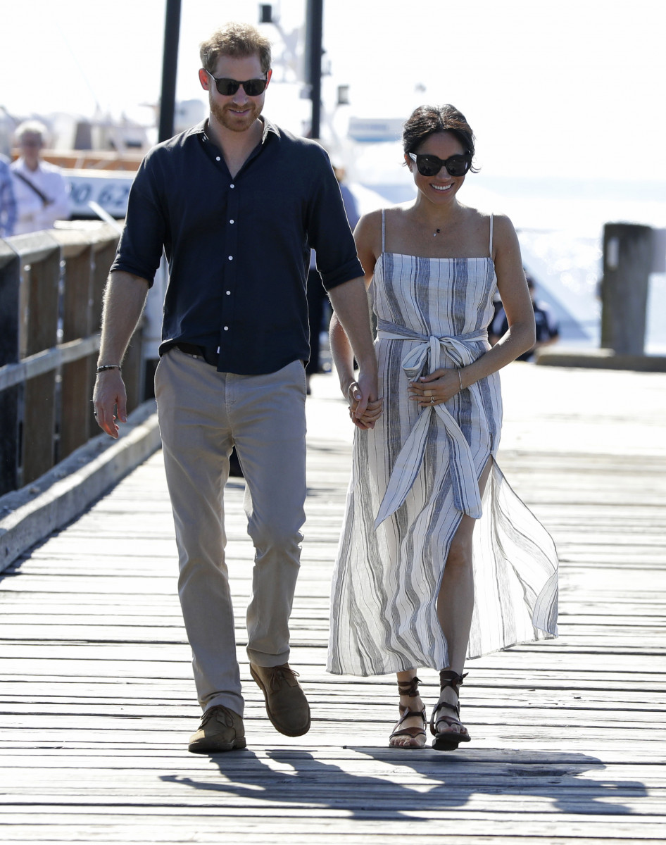 (credit: Kirsty Wigglesworth - Pool/Getty Images) Meghan, Duchess of Sussex and Prince Harry, Duke of Sussex walk along Kingfisher Bay Jetty during a visit to Fraser Island on October 22, 2018 on Fraser Island, Australia. The Duke and Duchess of Sussex are on their official 16-day Autumn tour visiting cities in Australia, Fiji, Tonga and New Zealand. (Photo by Kirsty Wigglesworth - Pool/Getty Images)