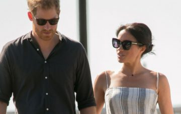 Meghan, Duchess of Sussex and Prince Harry, Duke of Sussex walk along Kingfisher Bay Jetty during a visit to Fraser Island on October 22, 2018 on Fraser Island, Australia. The Duke and Duchess of Sussex are on their official 16-day Autumn tour visiting cities in Australia, Fiji, Tonga and New Zealand. (Photo by Kirsty Wigglesworth - Pool/Getty Images)
