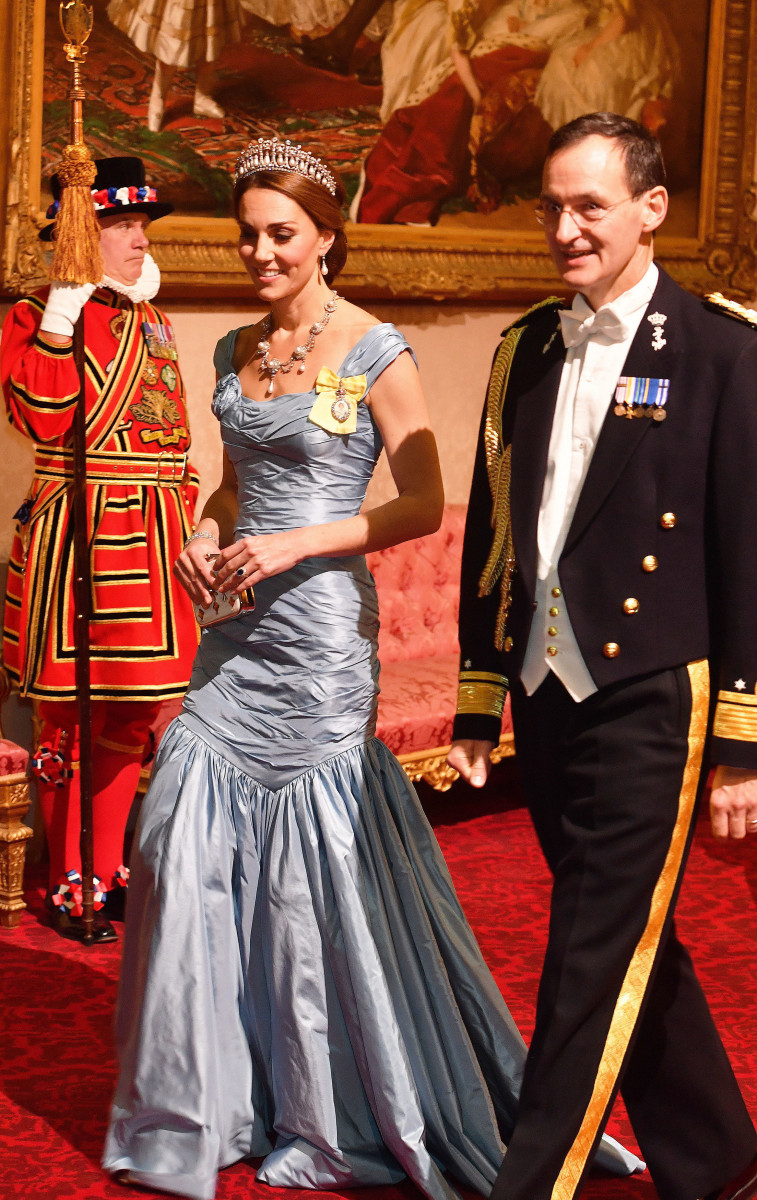 Catherine, Duchess of Cambridge walks with Rear Admiral Ludger Brummelaar during a State Banquet at Buckingham Palace on October 23, 2018 in London, United Kingdom. King Willem-Alexander of the Netherlands accompanied by Queen Maxima are staying at Buckingham Palace during their two day stay in the UK. The last State Visit from the Netherlands was by Queen Beatrix and Prince Claus in 1982. (Photo by John Stillwell - WPA Pool/Getty Images)