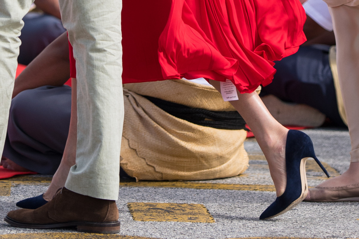 Prince Harry, Duke of Sussex and Meghan, Duchess of Sussex, shoe detail, as they arrive at Fua'amotu Airport