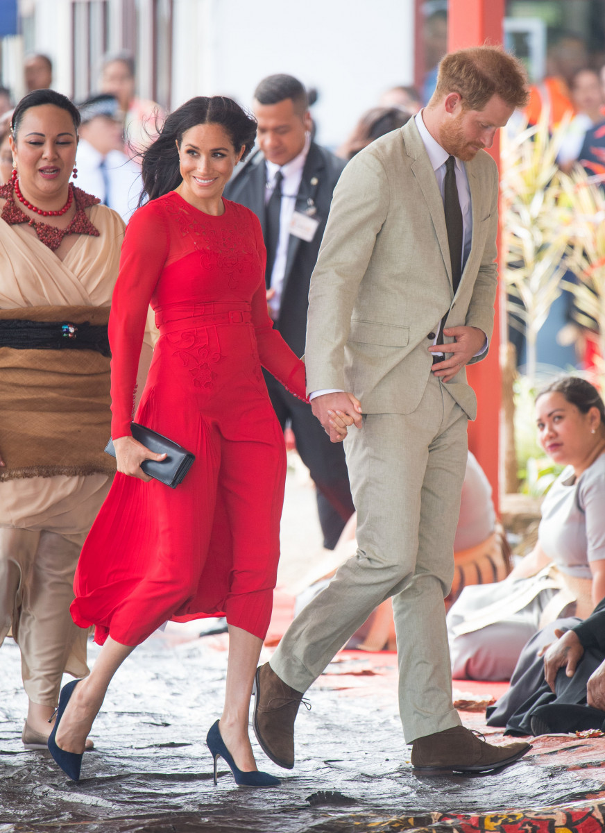 Prince Harry, Duke of Sussex and Meghan, Duchess of Sussex arrive at Fua'amotu Airport