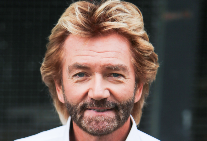 TV presenter Noel Edmonds is pictured leaving the ITV studios with his partner, Elizabeth Davies, following a guest appearance on 'This Morning'.